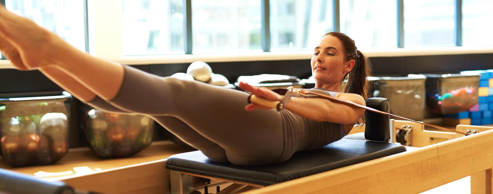 Esercizi con attrezzi Pilates